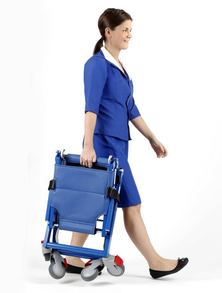 Stewardess carrying aircraft wheelchair